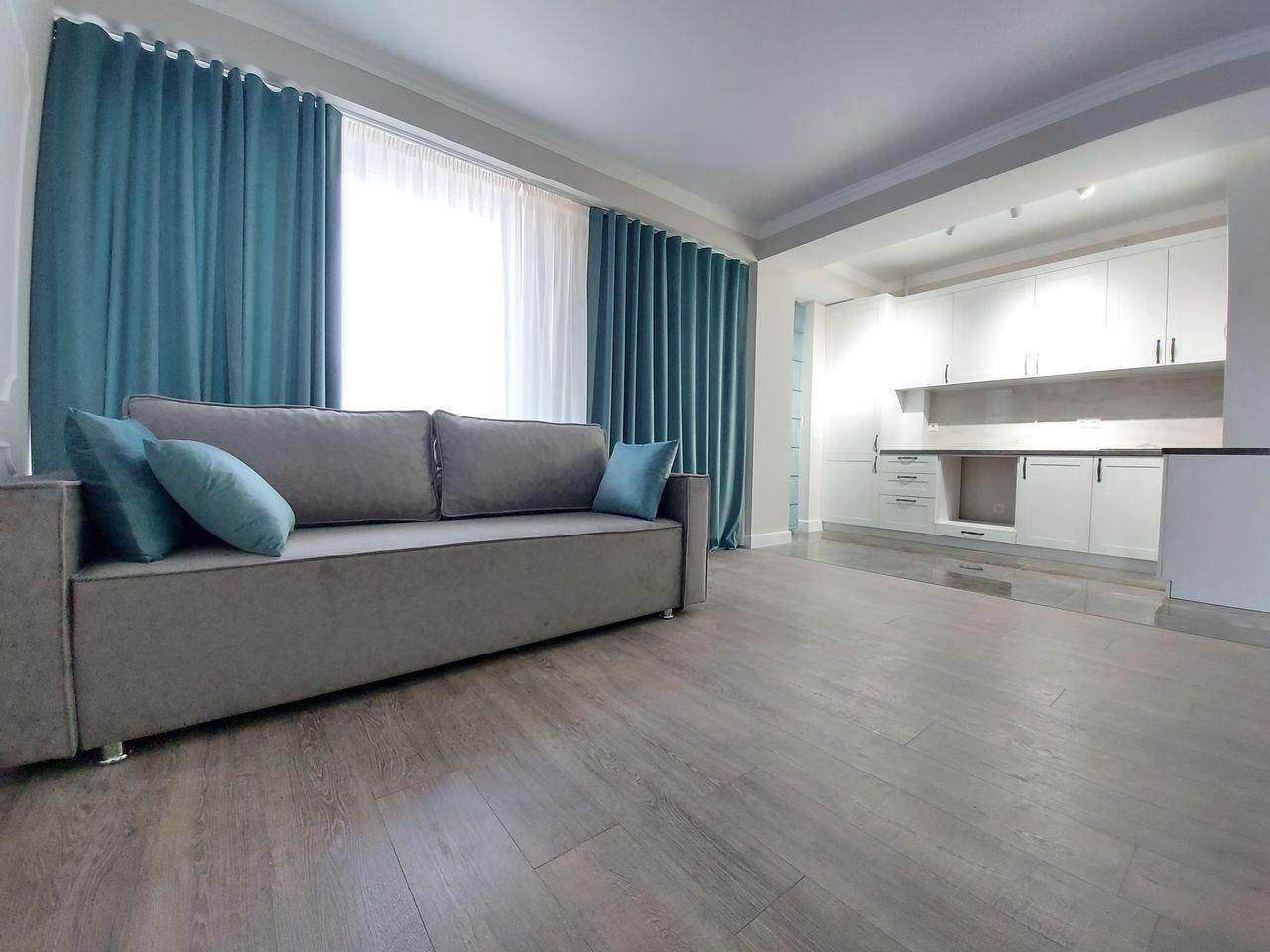 Apartament in centru Chisinaului – 2 camere + living